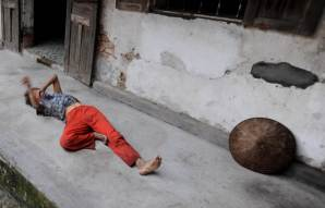 Their daughter Gam, 35, is blind and severely retarded. She is living outside the house like a wild animal. Gam is very strong and sometimes agressive. She is always very dirty from crawling around sometimes eating soil. Gam is a victim of a war, which ended before she was born.