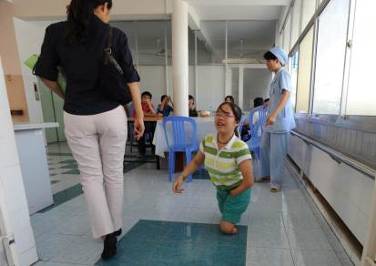 Hoan is defying her handicaps every day, running around on her deformed legs. Her dream is to become a doctor one day.