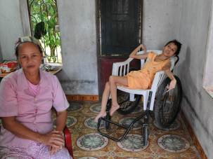 "During the war Nhan worked on the Ho Chi Minh Trail filling bomb craters. ""We were sprayed many times with a sticky substance by the American airplanes. We could taste in the water and food sometimes."" 27 years ago her daughter Huong was born."